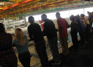 Students witness the construction of a Boeing 747.